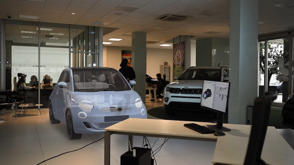 Mindesk simulation showing a car showroom with a white car added in Virtual Reality