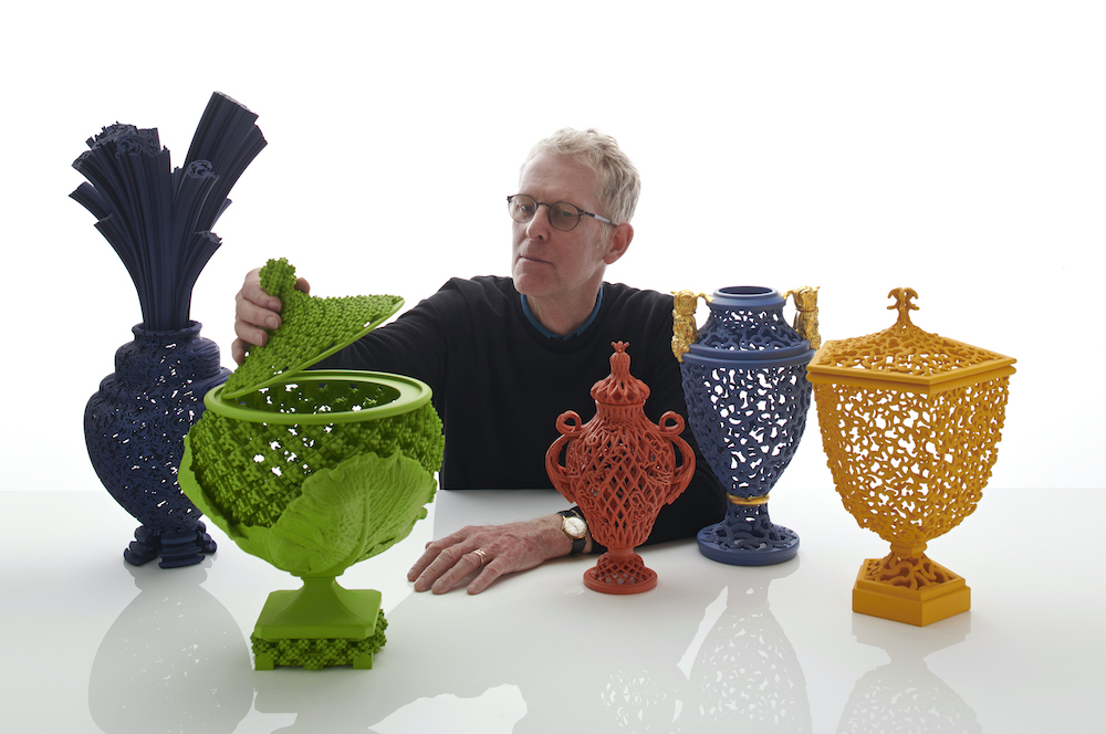 Photo of Michael Eden with some of his work.